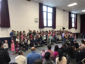 Students sing at the Spring Sing