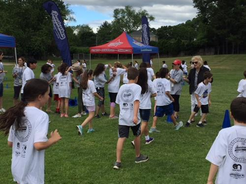 Students run towards to checkpoint at the fun run