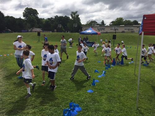 Students and teachers run together at the fun run
