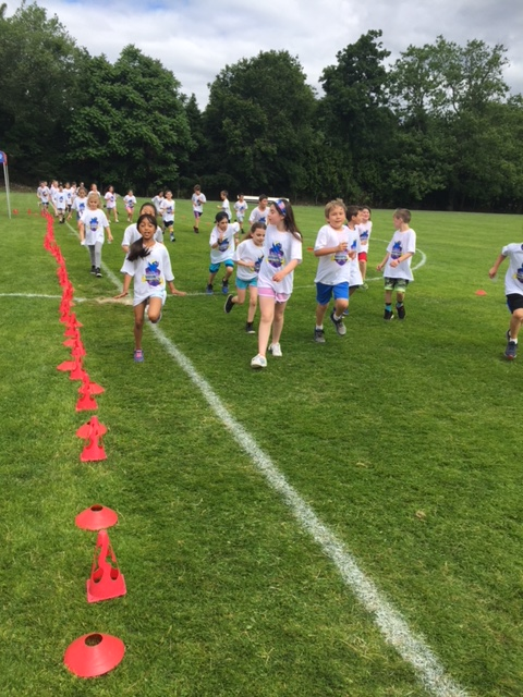 Students come down the straightaway at the fun run