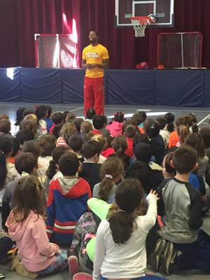 Smooth from the Harlem Wizards introduces himself to the students