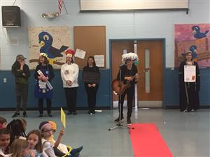 The teachers show their costumes for the vocabulary parade