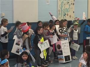 Students sing the vocabulary song at the vocabulary parade