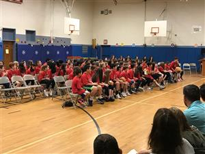 Fifth grade students listen to a speaker at the DARE graduation ceremony