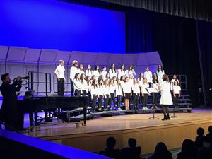 Middle School Chorus sings with accompaniment from Brian Lotze