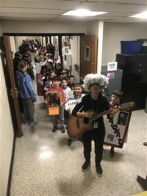 Students walk through the hallways in costume for the vocabulary parade